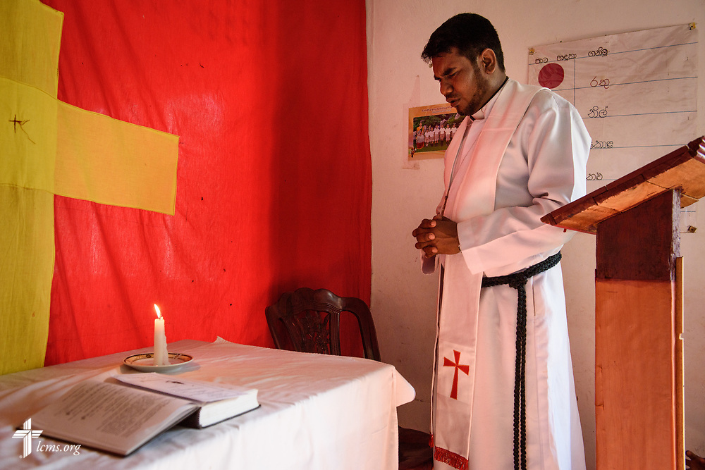 The Rev. P. Gnanakumar leads worship on the Eila rubber plantation in the Sabaragamuwa Province of Sri Lanka on Sunday, Jan. 21, 2018. LCMS Communications/Erik M. Lunsford