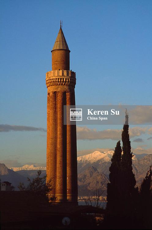 Sunset view of Yivli Minaret (Fluted Minaret), symbol of the city, Antalya, Turkey