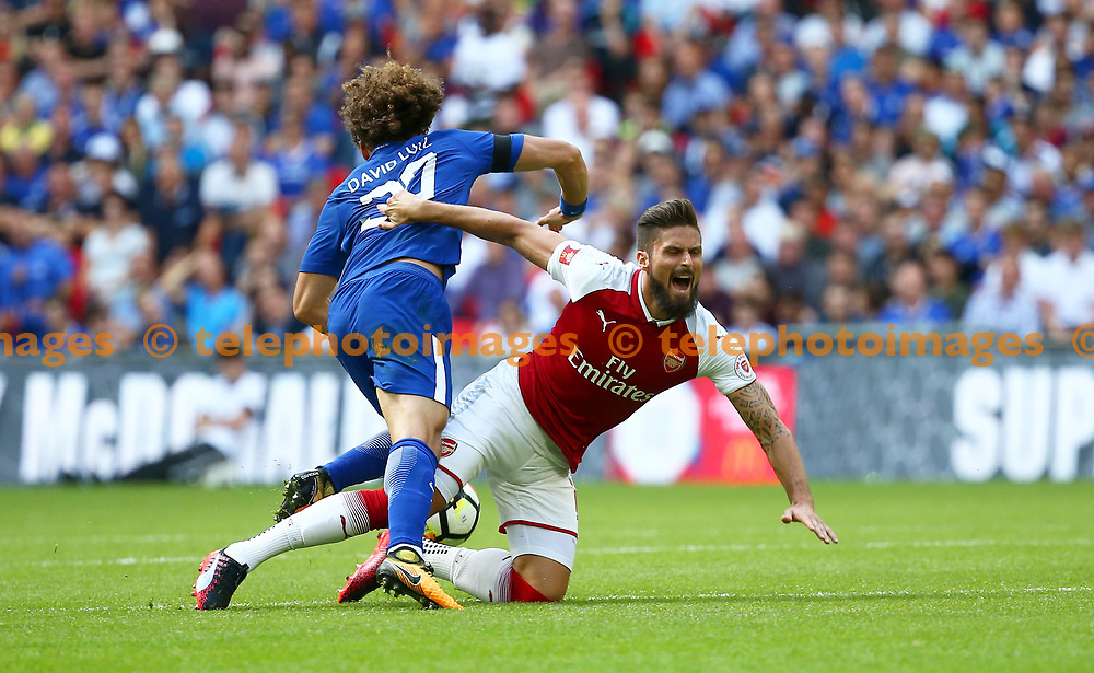 David Luiz of Chelsea brings down Olivier Giroud of Arsenal during the FA Community Shield match between Arsenal and Chelsea at Wembley Stadium in London. 06 Aug 2017