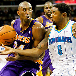 Dec 5, 2012; New Orleans, LA, USA; Los Angeles Lakers shooting guard Kobe Bryant (24) drives past New Orleans Hornets shooting guard Roger Mason Jr. (8) during the first half of a game at the New Orleans Arena.  Mandatory Credit: Derick E. Hingle-USA TODAY Sports