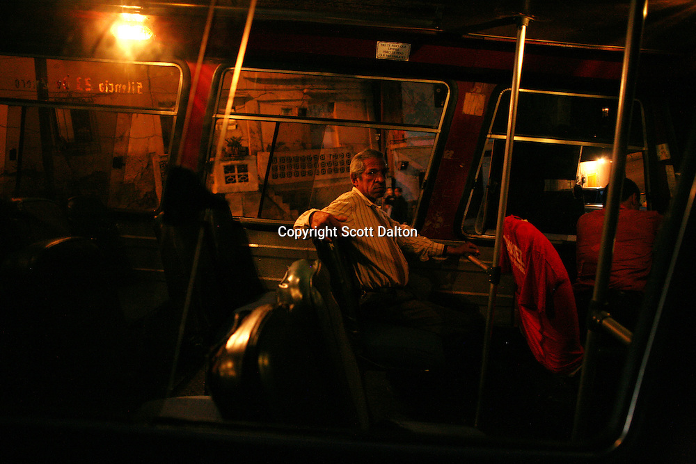 A man waits for a bus to start in 23 de Enero, a poor Caracas barrio that his heavily pro-Chavez, on November 29, 2006. (Photo/Scott Dalton)