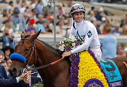 November 3, 2017 - Del Mar, California, U.S. - Jockey FLAVIEN PRAT and horse Battle of Midway in the winner's circle after they won the seventh race during the Breeders' Cup at the Del Mar racetrack on Friday. (Credit Image: © Hayne Palmour Iv/San Diego Union-Tribune via ZUMA Wire)