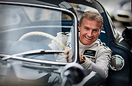 Former Formula One driver David Coulthard with the Mercedes 300SL gullwing in the assembly area at Goodwood.<br />