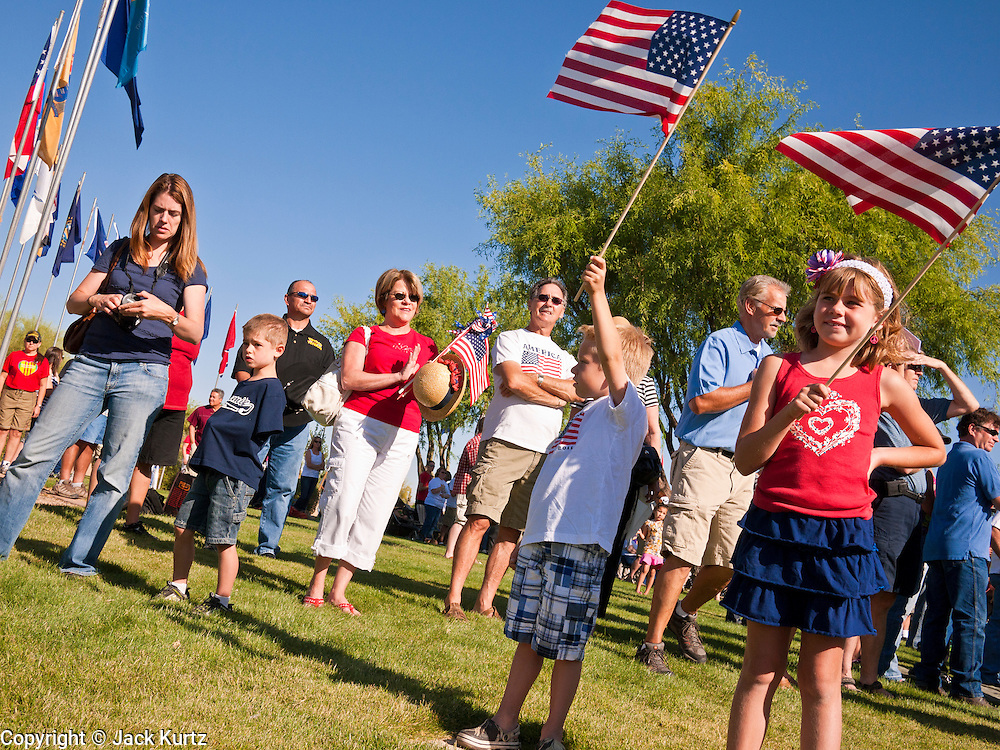 30 MAY 2011 - PHOENIX, AZ: Children with American flags at Memorial Day services in the National Memorial Cemetery in Phoenix, AZ, Monday. Memorial Day was celebrated with services across the United States Monday.    Photo by Jack Kurtz