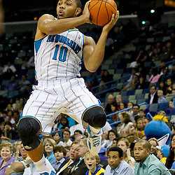 December 21, 2011; New Orleans, LA, USA; New Orleans Hornets shooting guard Eric Gordon (10) looks to passnagainst the Memphis Grizzlies during a preseason game at the New Orleans Arena.   Mandatory Credit: Derick E. Hingle-US PRESSWIRE
