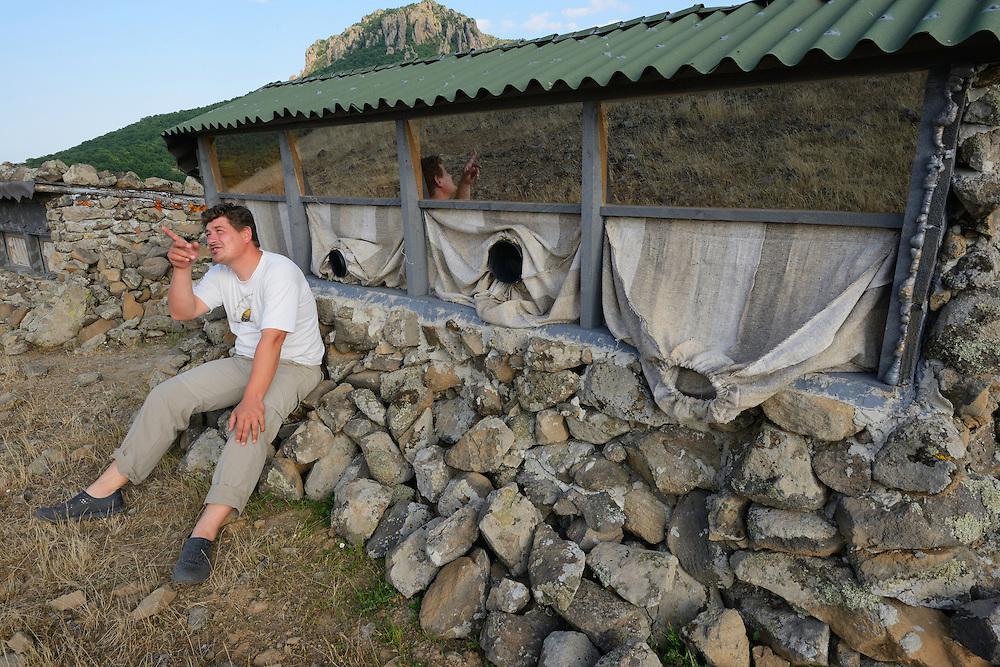Marin Kurtev, wildlife watching operator beside his Vulture watching hide, Madzharovo, Eastern Rhodope mountains, Bulgaria