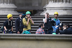 © Licensed to London News Pictures. 19/05/2016. London, UK. Climbers who scaled the building being questioned by police. A Greenpeace protest by Greenpeace at the British museum which has closed the museum. Greenpeace climbers have scaled pillars at the museum, erecting banners protesting against BP sponsorship of Sunken Cities: Egypts - Lost Worlds exhibition at the museum. ‎Photo credit: Ben Cawthra/LNP