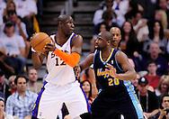 Mar. 10, 2011; Phoenix, AZ, USA; Phoenix Suns guard Mickael Pietrus (12) handles the ball against the Denver Nuggets guard Raymond Felton (20) at the US Airways Center. Mandatory Credit: Jennifer Stewart-US PRESSWIRE..