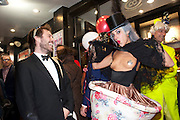 TOM BURKITT; STORM IS A TEACUP-SERENA MATTAR; ANDREW LOGAN, Premiere of 'The British Guide to Showing Off' Jes Benstock's documantary on Andrew Logan's life and 12 Alternative Miss World's. Prince Charles cinema, Leicester Place. London and afterward's at Moonlighting, Greek St. London. 6 November 2011. <br /> <br />  , -DO NOT ARCHIVE-© Copyright Photograph by Dafydd Jones. 248 Clapham Rd. London SW9 0PZ. Tel 0207 820 0771. www.dafjones.com.