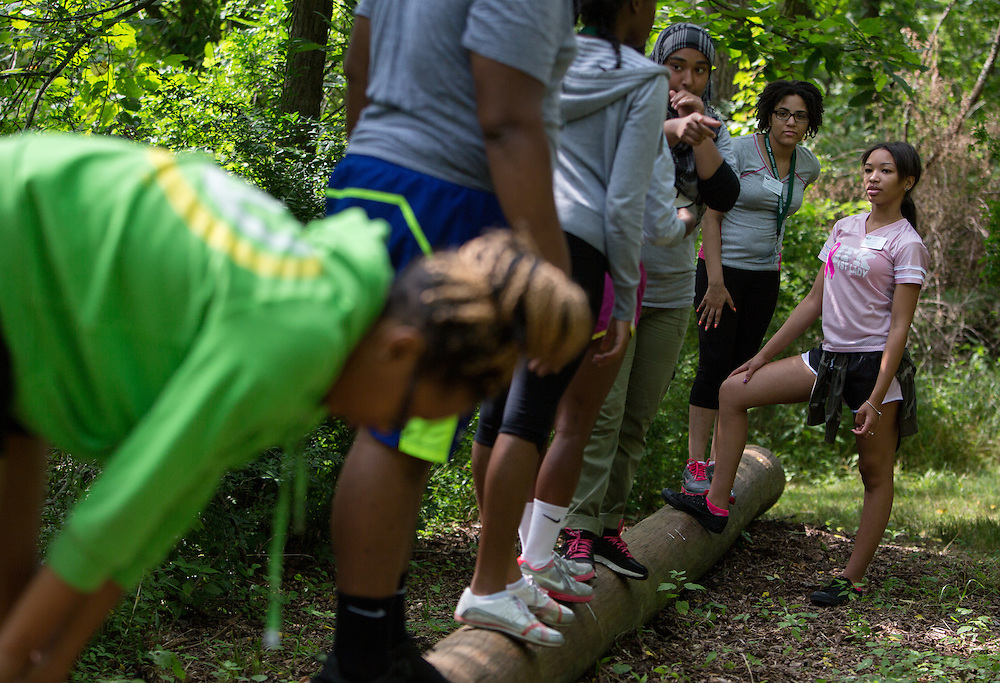 Participants in Ohio University's Junior Executive Business Program take part in a collaborative exercise during the Ropes Challenge Course on July 13, 2014. Photo by Lauren Pond.