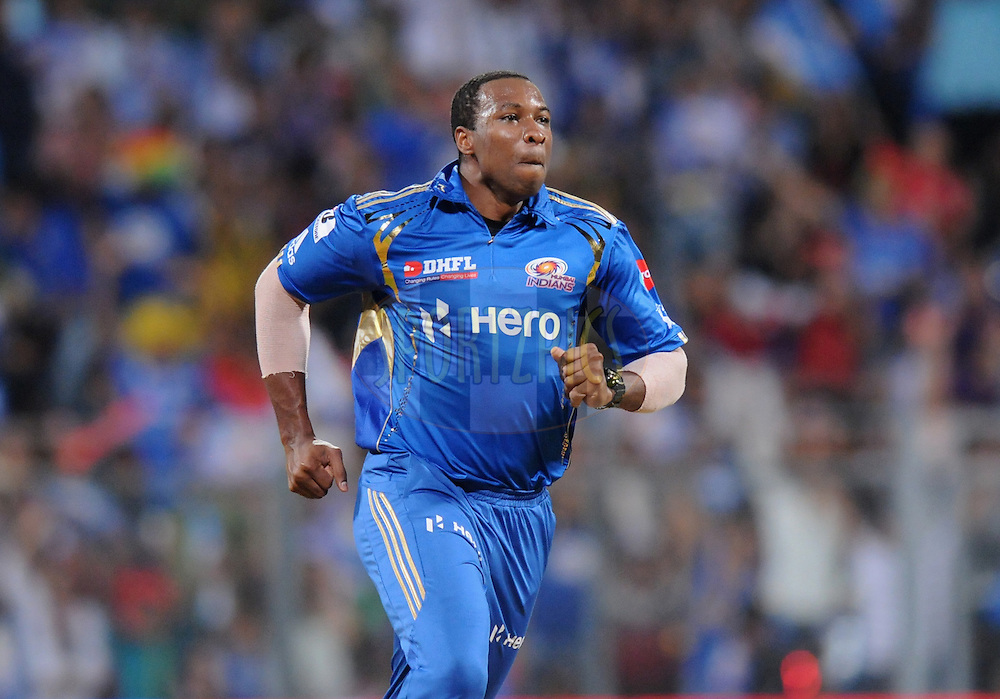 Kieron Pollard of Mumbai Indians celebrate the wicket of Gautam Gambhir captain of Kolkatta Knight Riders during match 65 of the Indian Premier League ( IPL) 2012  between The Mumbai Indians and the Kolkata Knight Riders held at the Wankhede Stadium in Mumbai on the 16th May 2012..Photo by Pal Pillai/IPL/SPORTZPICS.