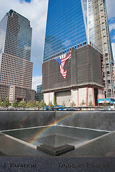 A Rainbow forms over the 9/11 Memorial Pool on a sunny and windy day