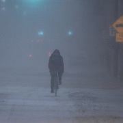 A pedestrian riding his bike down E. Main St. during a storm Friday, Jan, 22, 2016 in Newark.<br /> <br /> A massive blizzard dumps snow in Newark, and eastern United States on Friday, with mass flight cancellations, five states declaring states of emergency.