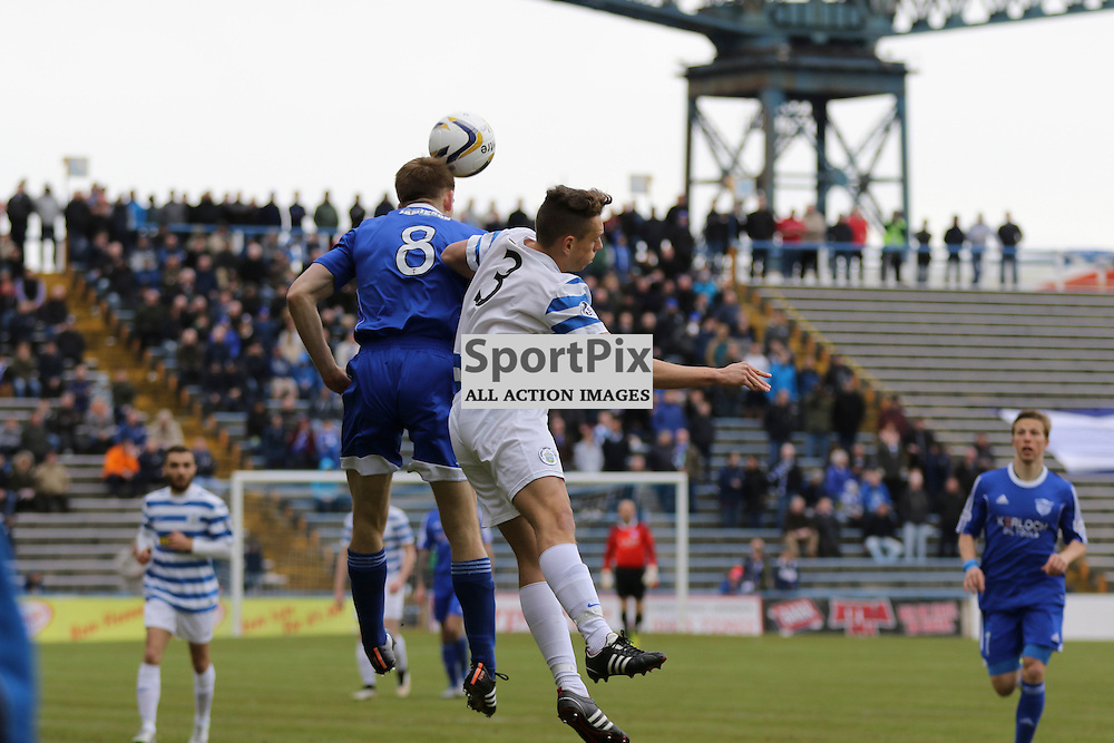 Jamie Redman goes up to headbut the ball while Mark Russell is also up there Greenock Morton v Peterhead, Scottish League One, 2 May 2015. (c )Paul Tipping | SportPixPix.org.uk