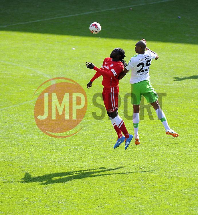 Cardiff City's Kenwyne Jones battles for the high ball with VfL Wolfsburg's Naldo - Photo mandatory by-line: Joe Meredith/JMP - Mobile: 07966 386802 02/08/2014 - SPORT - FOOTBALL - Cardiff - Cardiff City Stadium - Cardiff City v VfL Wolfsburg - Pre-Season Friendly