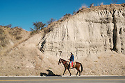 A Mexican cowboy rides though the high desert to join the annual Cabalgata de Cristo Rey cowboy pilgrimage January 4, 2017 in Guanajuato, Mexico. Thousands of Mexican cowboys and horse come from all over to take part in the three-day ride to the mountaintop shrine of Cristo Rey.