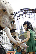 The gigantic mechanical elephant, and the Sultan, encounter the  Little Girl of the play, on Friday, May 5, 2006. The Sultan's Elephant show, for the first time in London is a magical, and unique in the world, theatrical show across the streets, performed by an international French company - Royal De Luxe - specialised in constructing and giving 'life' to enormous mechanical puppets. The Sultan's Elephant is the story of a Sultan dreaming of a little girl that travels through time. **ITALY OUT**