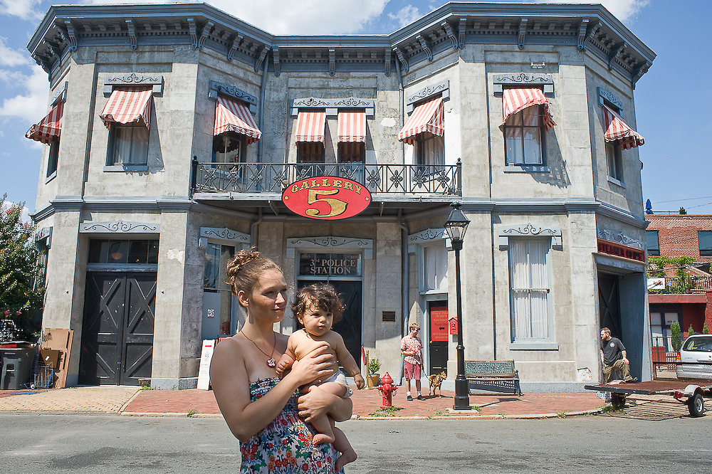 Richmond, VA - June 28, 2009 - Amanda Robinson Khodabandeh,Founding Executive Directorof Gallery 5 poses with her daughter Azadeh, 6 months outside her gallery, Gallery 5.  Her great-grandfather, grandfather, and great uncles were all firefighters in the former fire station,  the 1849 building is Virginia's oldest fire station (and the third oldest in the United States) and was also a jail..Photo © Susana Raab 2009