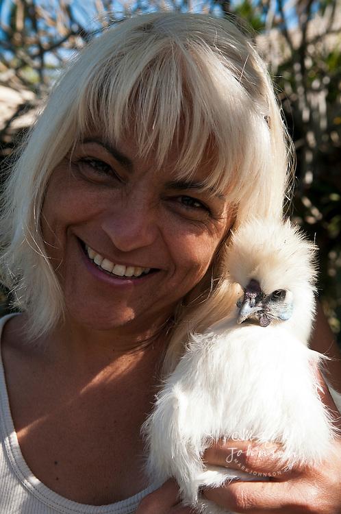 "Woman holding freerange ""white silkie"" pet hen"