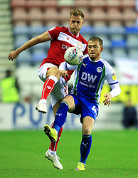 Bristol City's Tomas Kalas challenges Wigan Athletic's Joe Garner - Mandatory by-line: Matt McNulty/JMP - 21/09/2018 - FOOTBALL - DW Stadium - Wigan, England - Wigan Athletic v Bristol City - Sky Bet Championship