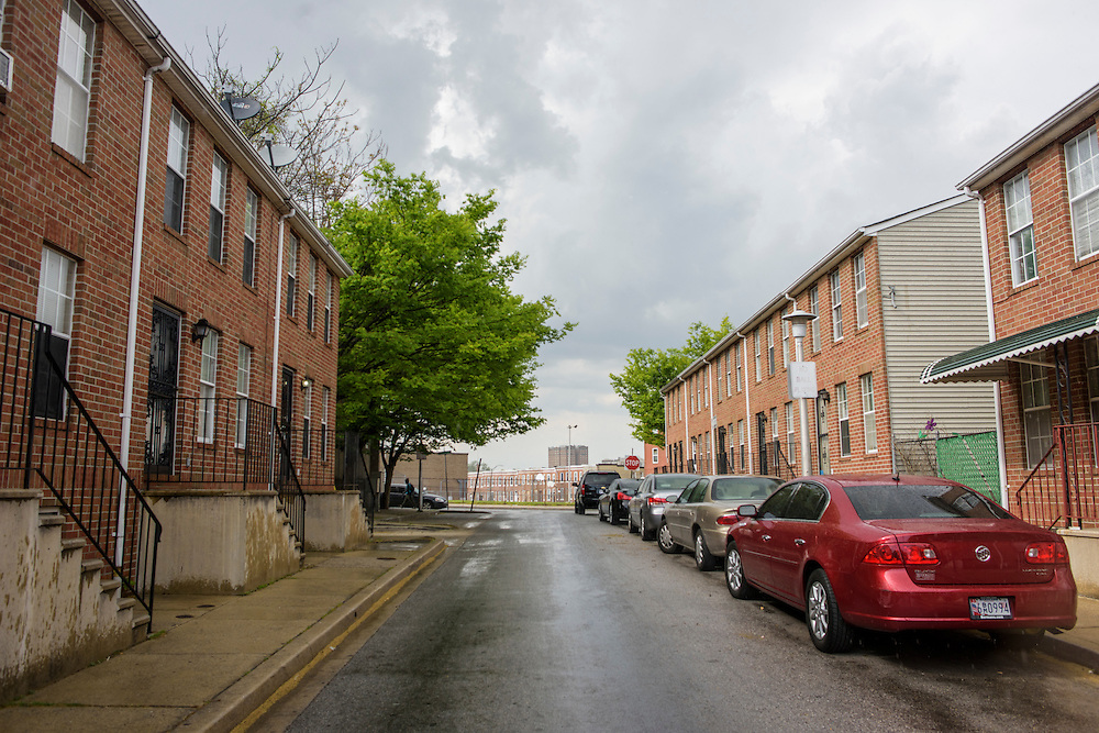 Baltimore, Maryland - April 30, 2015: A block of newer town homes built in the 90's in the Sandtown neighborhood of Baltimore. After retiring as CEO of the Rouse corporation, Jim Rouse found the Enterprise Foundation, and aimed at revitalizing Sandtown. After he died, the project stalled, and the economics of Sandtown stayed the same. <br /> <br /> The poor, predominately black area of Baltimore known as Sandtown is where the most violent riots occurred the week Freddie Gray was laid to rest. Tensions between the are's residents and police have been bubbling long before Freddie Gray died while in police custody. <br /> <br /> CREDIT: Matt Roth for The Globe and Mail