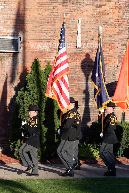 Middletown, N.Y.  - The Orange County Sherrif's Office color guard marches  during a  crime victims ceremony at Festival Square on April 29, 2009.