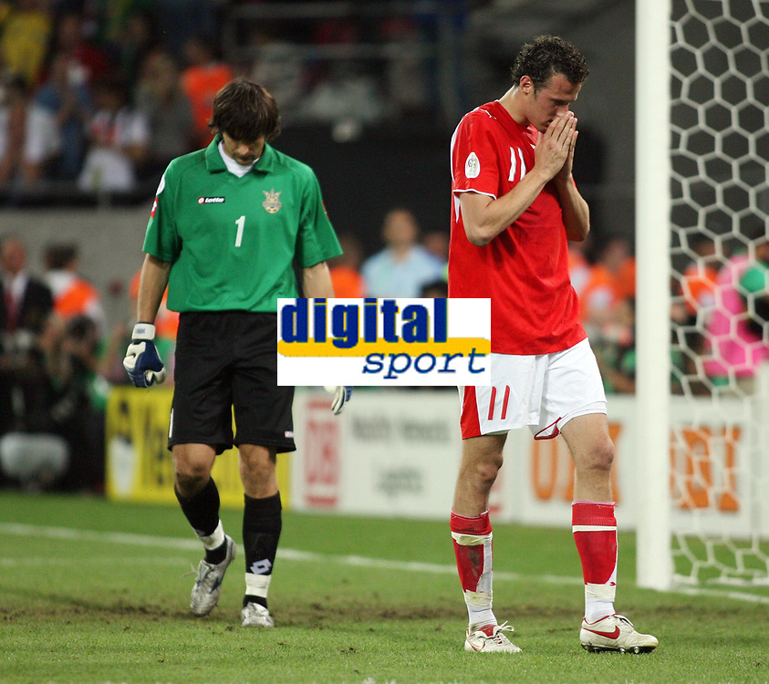 Photo: Chris Ratcliffe.<br /> Switzerland v Ukraine. 2nd Round, FIFA World Cup 2006. 26/06/2006.<br /> Oleksandr Shovkovskyi of Ukraine in the background has just saved the penalty from Marco Streller of Switzerland.