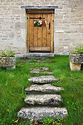 Wooden door of a house in the Cotswolds, Oxfordshire, United Kingdom