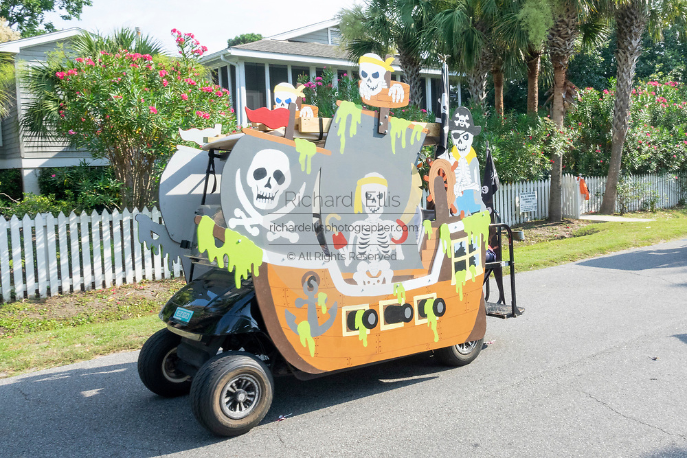 A golf cart float decorated as a pirate ship rides down the road during the annual Independence Day parade July 4, 2019 in Sullivan's Island, South Carolina. The tiny affluent Sea Island beach community across from Charleston holds an outsized golf cart parade featuring more than 75 decorated carts.