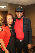 April 15, 2012 Washington, D.C:  (L-R) Umi (Mother) and Recording Artist Yasiin Bey (Formely known as Mos Def) Produced in Association with Jill Newman Productions backstage at the legendary Howard Theater on April 15, 2012 in Washington, DC. ..Regarded as one of hip-hop's most introspective and insightful artists, Yasiin Bey (formerly known as Mos Def) has shaped a career that transcends music genres and artistic mediums. A child of hip-hop's Golden Era, this native Brooklynite spent his childhood embedded in the culture surrounding him as well as absorbing knowledge from across the artistic spectrum..(Terrence Jennings/Polaris).