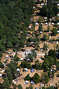 Nederland, Utrecht, Gemeente Utrechtse Heuvelrug, 08-07-2010; Caravans tussen de bomen op camping met eigen zwembad 'Het Grote Bos', omgeving Doorn..Caravans between the trees on camping site 'The Great Forest', with private pool, Doorn area..luchtfoto (toeslag), aerial photo (additional fee required).foto/photo Siebe Swart