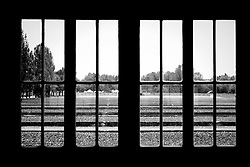 """Dachau concentration camp was the first Nazi concentration camp opened in Germany, located on the grounds of an abandoned munitions factory near the medieval town of Dachau, about 16 km northwest of Munich in the state of Bavaria, which is located in southern Germany. Opened 22 March 1933 (51 days after Hitler took power), it was the first regular concentration camp established by the coalition government of the National Socialist Party (Nazi Party) and the German Nationalist People's Party. Heinrich Himmler, then Chief of Police of Munich, officially described the camp as """"the first concentration camp for political prisoners."""""""
