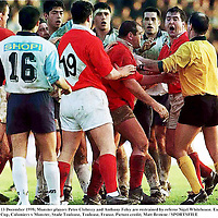 13 December 1998; Munster players Peter Clohessy and Anthony Foley are restrained by referee Nigel Whitehouse. European Rugby Cup, Colomiers v Munster, Stade Toulouse, Toulouse, France. Picture credit; Matt Browne / SPORTSFILE