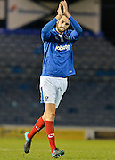 Portsmouth defender Christian Burgess celebrates at the final whistle during the Sky Bet League 2 match between Portsmouth and York City at Fratton Park, Portsmouth, England on 24 November 2015. Photo by Adam Rivers.