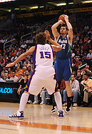Mar. 16 2010; Phoenix, AZ, USA; Minnesota Timberwolves forward Kevin Love (42) puts up a shot against Phoenix Suns center Robin Lopez (15) in the first half at the US Airways Center. Mandatory Credit: Jennifer Stewart-US PRESSWIRE.