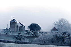 © Licensed to London News Pictures. 20/01/2016. Llanddewi'r Cwm, Powys, Wales, UK. After a night with temperatures dropping to minus 5 degrees centigrade, St David's Church is seen surrounded by freezing fog in the tiny hamlet of Llanddewi'r Cwm in Mid Wales. Photo credit: Graham M. Lawrence/LNP