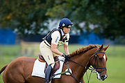 Pippa Funnell in the cross-country phase of an eventing competition, Charlton Park, Wiltshire, United Kingdom