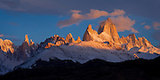 Brilliant light of a Patagonian sunrise illuminates Mt. Fitzroy in the Southern Andes, Argentina, South America