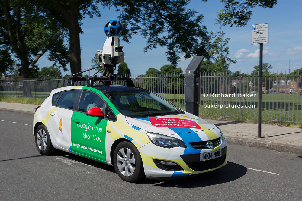 A Google Street View mapping car drives alongside a public park in the borough of Lambeth,on 1st June 2017, in south London, England.