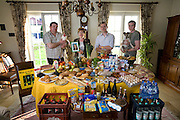 Family of Carlo and Marie Paule Kutten-Kass, Luxembourg with one week's worth of food. Photographed in their dining room. MODEL RELEASED. Carlo and Marie Paule Kutten-Kass of the town of Erpeldange in Bous, southeast of Luxembourg City, near the German border. The image is part of a collection of images and documentation for Hungry Planet 2, a continuation of work done after publication of the book project Hungry Planet: What the World Eats.