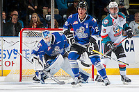 KELOWNA, CANADA - DECEMBER 30: Kole Lind #16 of the Kelowna Rockets looks for the pass behind Chaz Reddekopp #29 as Griffen Outhouse #30 of the Victoria Royals defends the net on December 30, 2016 at Prospera Place in Kelowna, British Columbia, Canada.  (Photo by Marissa Baecker/Shoot the Breeze)  *** Local Caption ***