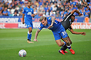 Peterborough United forward Jason Cummings (35) is fouled by Portsmouth defender Nathan Thompson (20) during the EFL Sky Bet League 1 match between Peterborough United and Portsmouth at London Road, Peterborough, England on 15 September 2018.