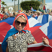 MIAMI, FL - NOVEMBER 26: Miami residents  like Libis Morales, 46, react to the news of the death of former Cuban President Fidel Castro Ruz. Many, mostly Cubans, gathered outside popular Miami restaurant Versailles to wave flags and celebrate the news, on NOVEMBER 26, 2016 in Miami, Florida. (Photo by Angel Valentin/Getty Images)