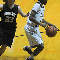 New Hanover's Taylor Perkins drives around Ashley's Morgan Carpenter Friday December 19, 2014 at New Hanover High School in Wilmington, N.C. (Jason A. Frizzelle)