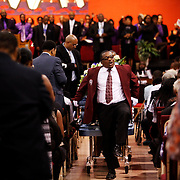 A pallbearer does a high step as he carries out the casket at the conclusion of the funeral of Terence Crutcher in Tulsa, Oklahoma, U.S., September 24, 2016. REUTERS/Kurt Steiss
