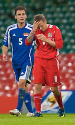CARDIFF, WALES - Saturday, October 11, 2008: Wales' captain Craig Bellamy looks dejected after being shown the yellow card during the 2010 FIFA World Cup South Africa Qualifying Group 4 match against Liechtenstein at the Millennium Stadium. (Photo by David Rawcliffe/Propaganda)