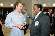 Bendik Hofseth Norwegian saxophonist and Chairman of the International Council of Music Composers chats with Lamont Dozier, song writer and producer at Motown Records at the World Copyright Summit at the Ronald Reagan Center, Washington, DC, Monday, June 8, 2009.