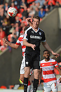 Marley Watkins of Barnsley FC and Richard Wellens of Doncaster Rovers during the Sky Bet League 1 match between Doncaster Rovers and Barnsley at the Keepmoat Stadium, Doncaster, England on 3 October 2015. Photo by Ian Lyall.