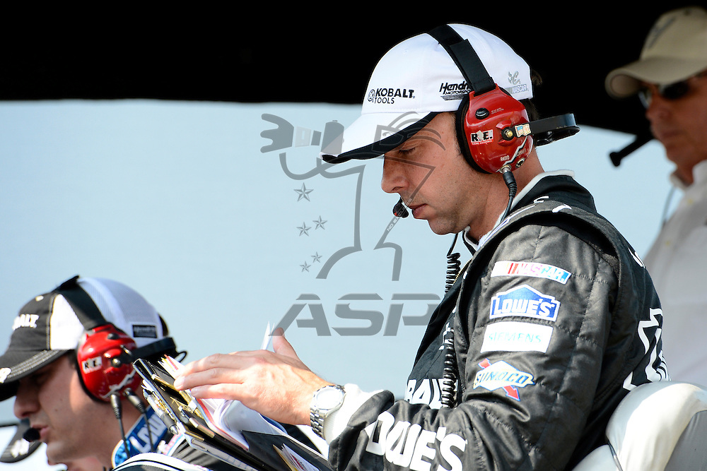Joliet, IL - SEP 16, 2012: Chad Knause looks at notes during the Geico 400 at the Chicagoland Speedway in Joliet, IL.