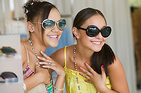 Girls Trying on Sunglasses in store